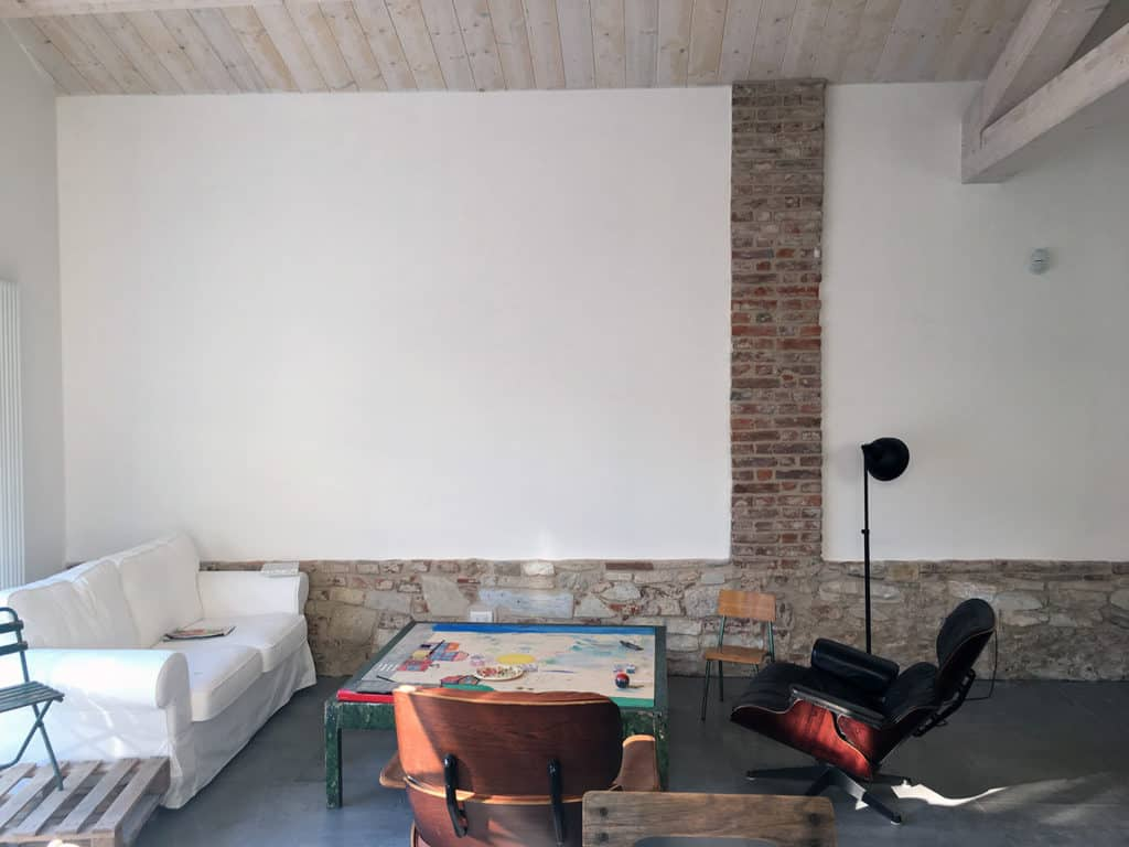 Pietrasanta, livingroom design, Eames chair, natural materials